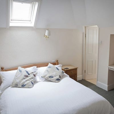 Interior shot of a bedroom at Lattice Lodge - Small Double Room