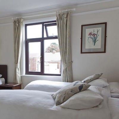 Interior shot of a bedroom at Lattice Lodge - Triple Room